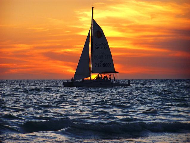 sailboat with orange sunset