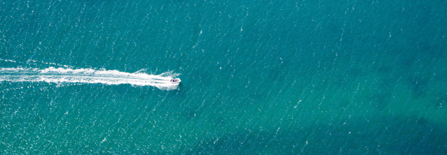 Ariel photo of yacht on clear water