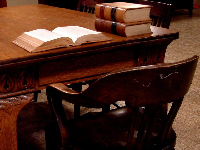 law office wooden table with legal books