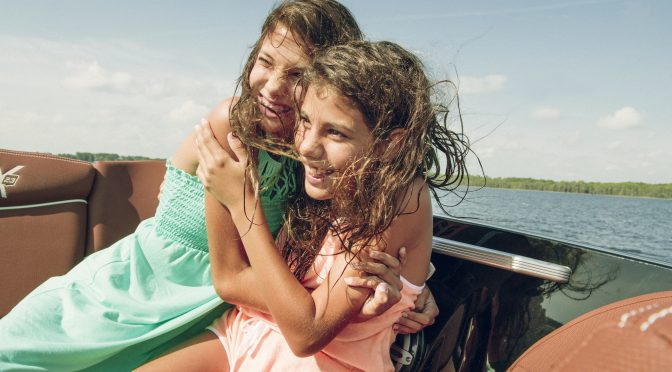 girls hugging on boat ride
