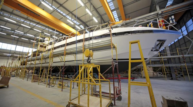 Yacht manufacturer - yacht inside marine business being built