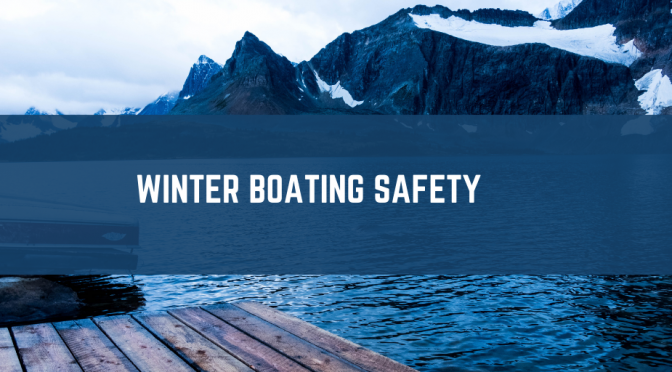 Winter Boating Safety lake and mountain range with snow